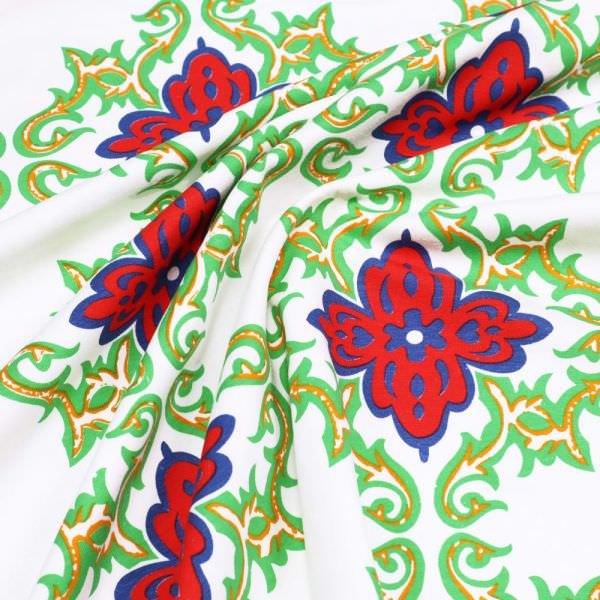 Baumwolljersey Ornamente & Blumen - weiss/rot/blau/grün/orange